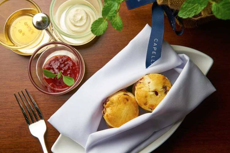 Scones served ith Cranberry served with honey, jam and cream