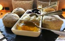 Scones with fruit jam, marmalade and Chantilly cream.