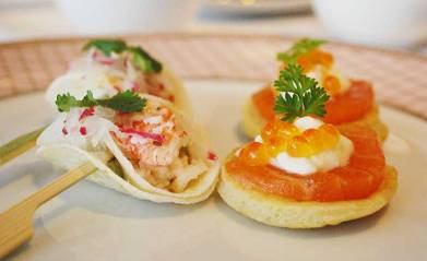 Spanner crab taco with avocado, chipotle mayo and lime, and Cured salmon buttermilk blini, cottage cheese and smoked roe