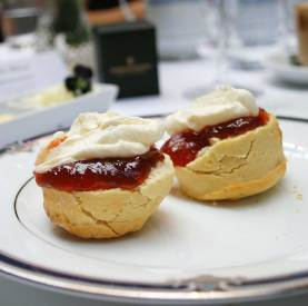 Freshly baked buttermilk and fruit scones with jam and cream