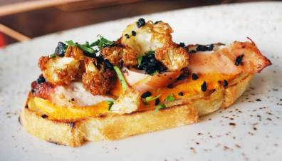 Charred octopus with romesco with fried cauliflower