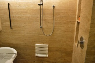 The shower was placed next to the bathtub, with no division