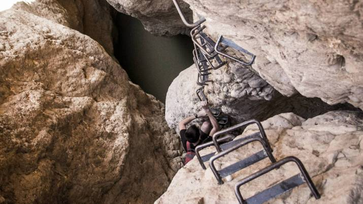 climbing ladders in mishmar canyon