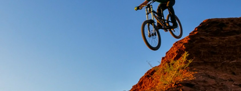 a mountain biker riding downhill in St. George