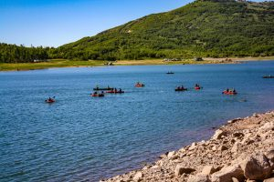 Kids playing in canoes on Kolob Reservoir