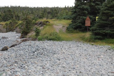 The trail starts on a cobblestone beach.