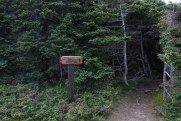 A trail marker keeps hikers away from private property.