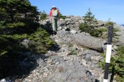 Traversing over rocks at the start of the trail