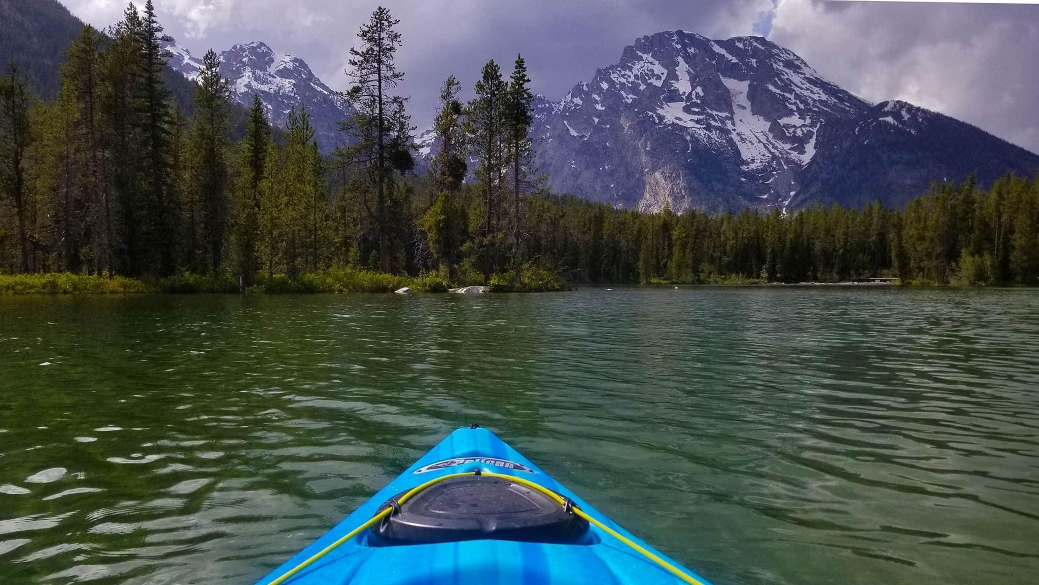 Kayaking String Lake in June with Mt Moran