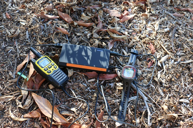 ibattz Battstation Optimus charging a walkie talkie and GPS watch