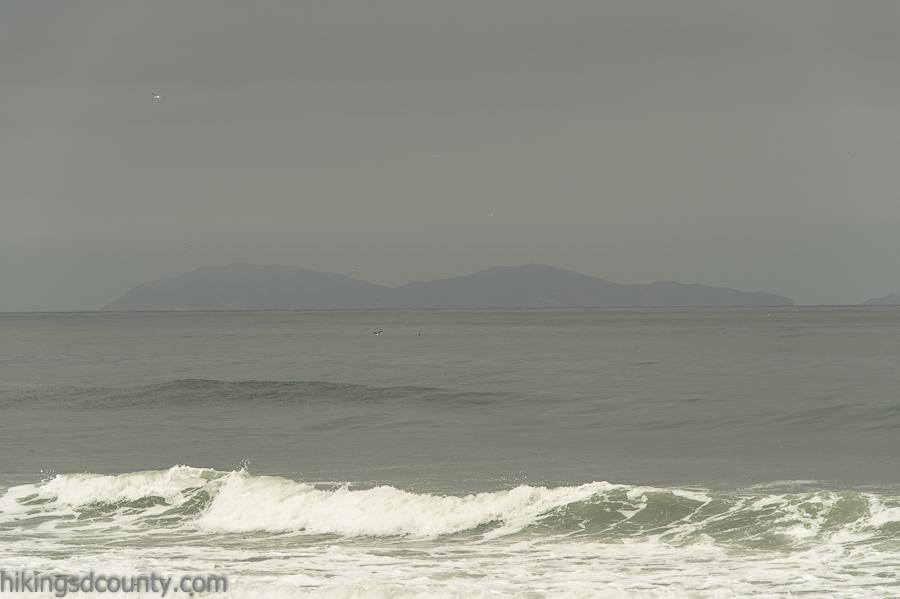 The hazy outline of the Coronado islands off the coast of Baja California