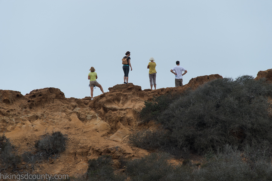 Hikers enjoy the view from Red Butte at Torrey Pines