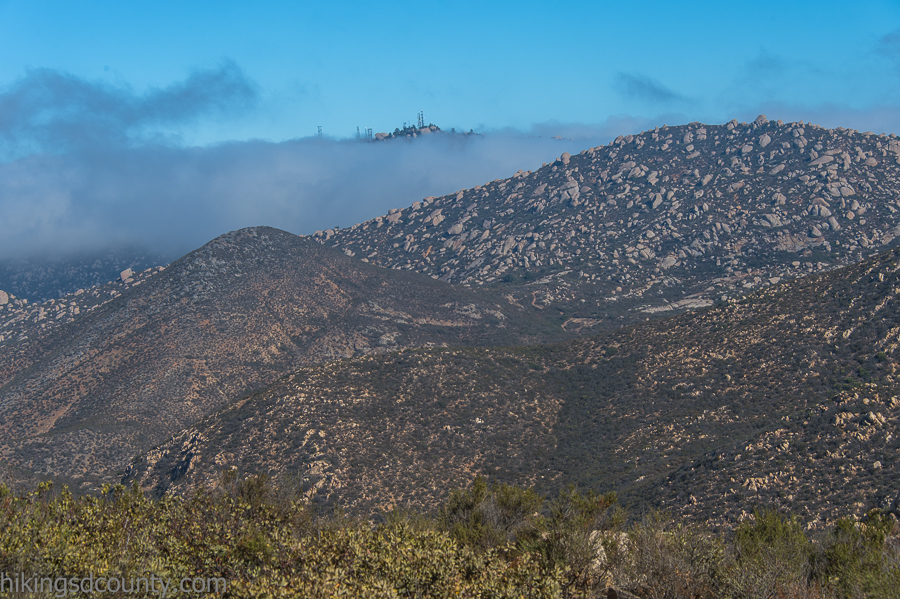 The tpp of Mount Woodson  emerges from the clouds