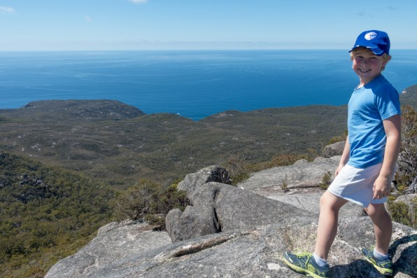 Luke looking decidedly happier on the summit