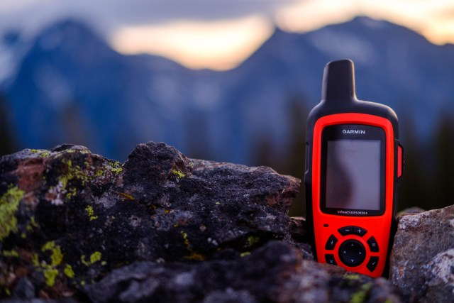 Garmin inReach GPS Communicator on a rock outcropping in the mountains