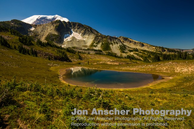 Rainier towering above a lake in Windy Gap
