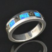 Dinosaur bone and lab created opal man's wedding band in sterling silver.