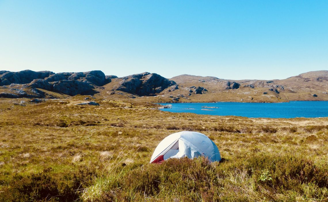 Wild camping by a loch in the Scottish Higlands