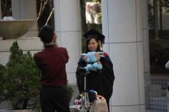 Graduate with stuffed animal