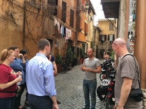 Federico regales his bike tour group over gelati