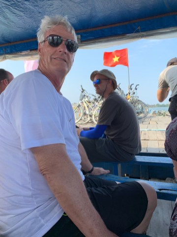 Taking a boat to another island - bike tour, Hoi An
