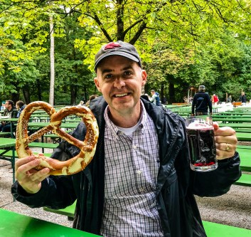 Big pretzel and a mug of sparkling cranberry juice at the Chinese Tower Beer Garden in Munich
