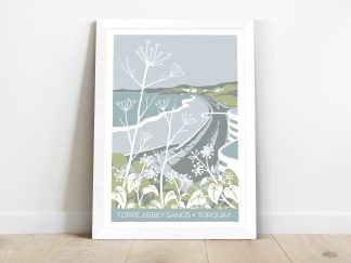 framed print of Torre Abbey Sands beach in Torquay, Devon. Coastal art featuring winter plants