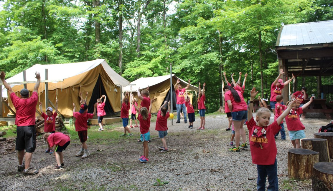 Children playing outside tents