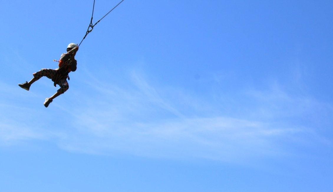 Young girl on big swing adventure equipment