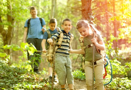 Children hiking on trail stock image