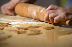 Gingerbread cookies being rolled out with a roller
