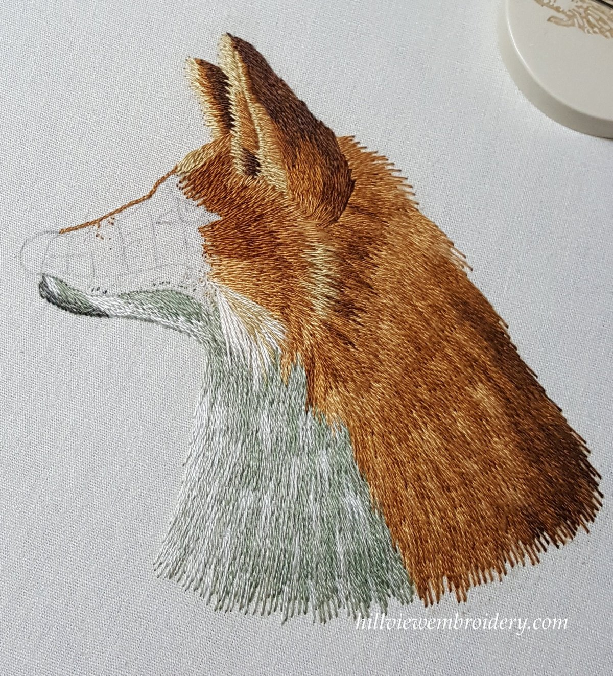 Working the chin of a fox in long and short stitch
