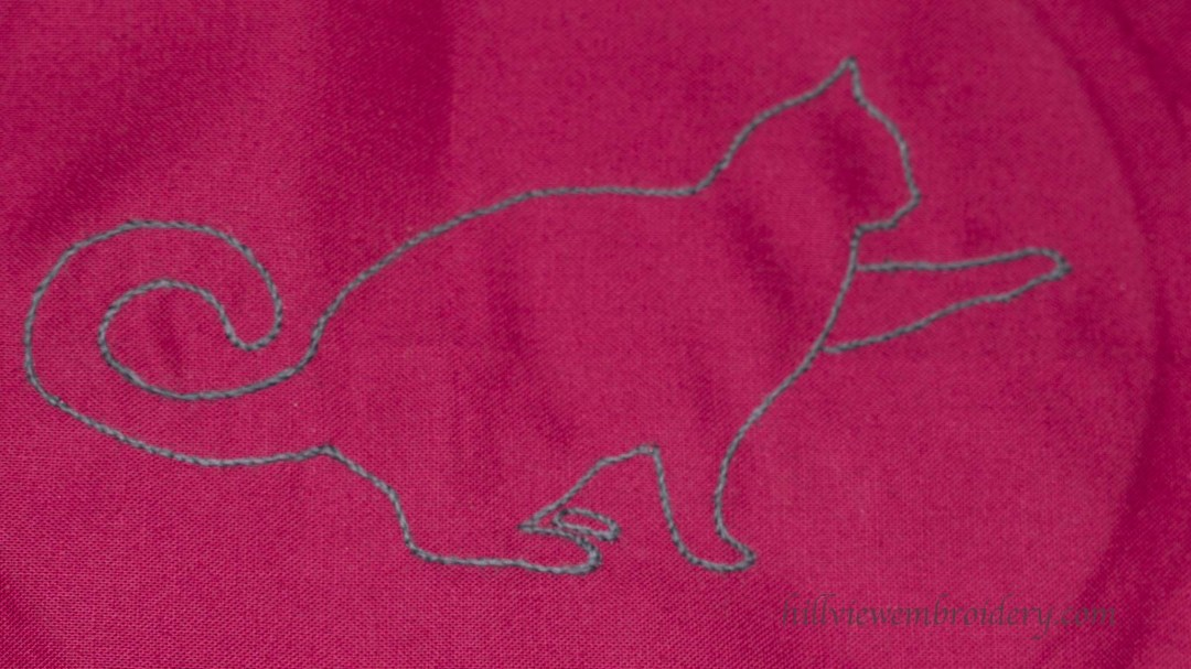 A silhouetted cat for a simple but effective design on a hand embroidered gift
