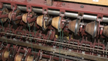 Wrapping bobbins with the finished thread