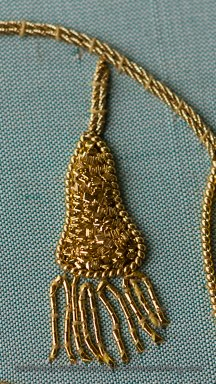 goldwork embroidery sample demonstrating pearl purl outline and chipwork