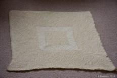 Garter stitch baby blanket with stocking stitch diamond