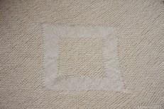 Detail of stocking stitch 'square' on diagonal garter stitch