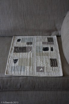 Mini-quilt on sofa