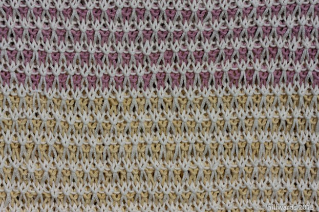 Detail of coloured slip stitches in knit blanket