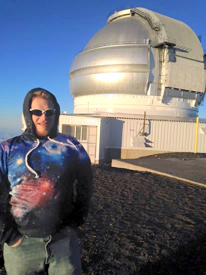 Derek standing in front of observatory dome