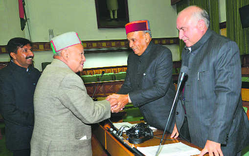 Chief Minister Virbhadra Singh with Leader of the Opposition PK Dhumal during the first day of the Budget session in Shimla