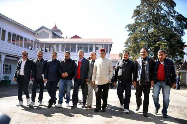 Chief Minister Prem Kumar Dhumal and other BJP MLAs stage a walkout in Shimla on Thursday