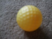 yellow plastic golf ball
