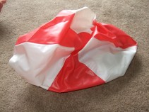 flat red and white beach ball
