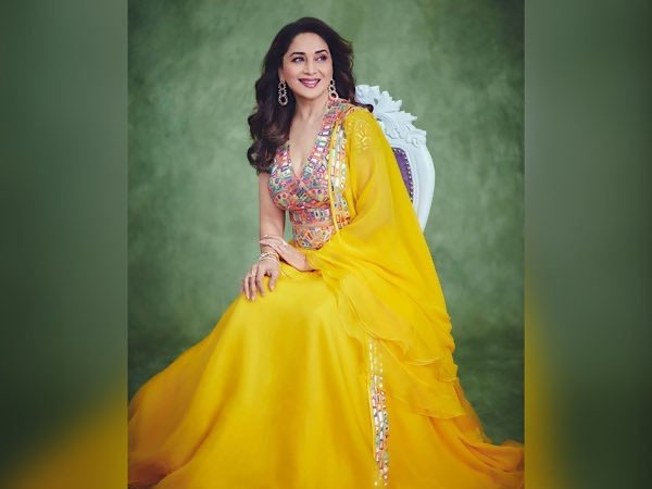 Bollywood Actress Madhuri Dixit In Black Saree And Yellow Lehenga Look