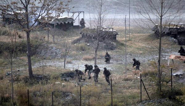 KASHMIR, INDIA - DECEMBER 05: Smoke rises from a bunker as Indian Army soldiers search for suspected militants after an attack on their base at Mohra, in Kashmir, India on December 05, 2014. Militants sneaked into an Indian army camp in Kashmir on Friday morning killing at least ten soldiers and police in their bunkers, the worst losses for security forces in more than a year.  (Photo by Ahmer Khan/Anadolu Agency/Getty Images)