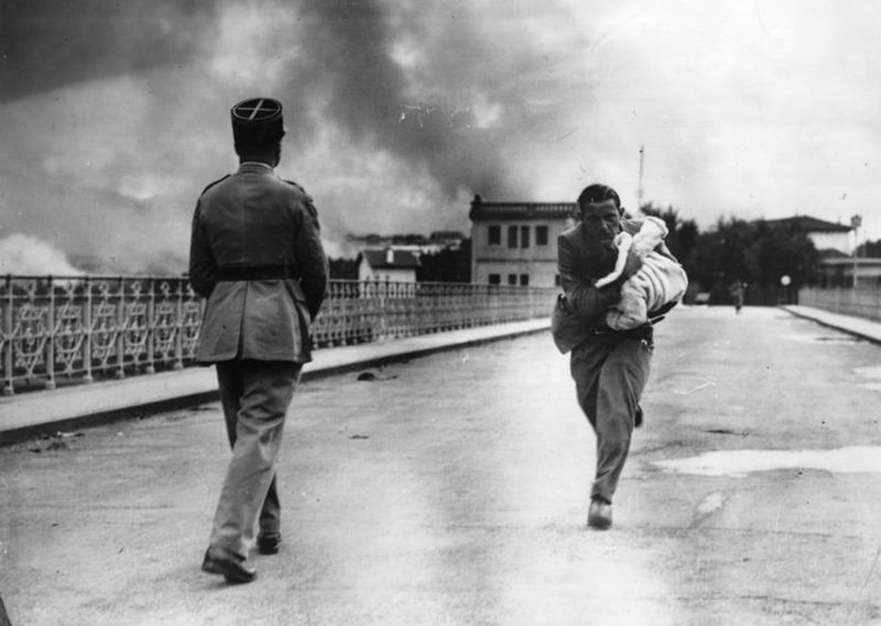 a-journalist-runs-across-a-bridge-to-rescue-a-baby-during-the-civil-war-in-1936
