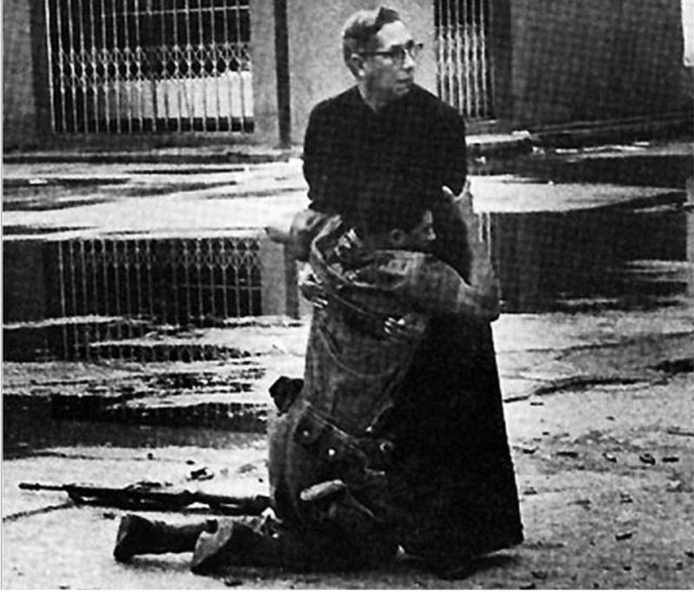 navy-chaplain-luis-padillo-gives-last-rites-to-a-soldier-wounded-by-sniper-fire-during-a-revolt-in-venezuela