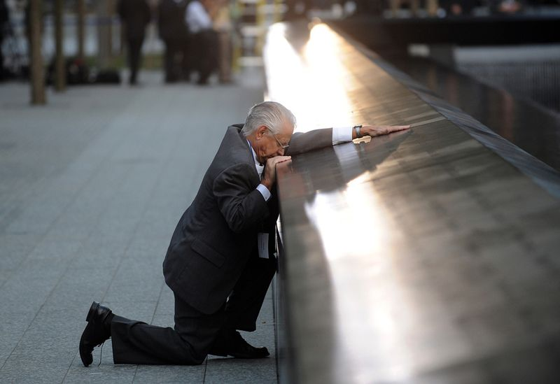 robert-peraza-falls-to-his-knees-as-he-touches-his-sons-name-at-the-911-memorial