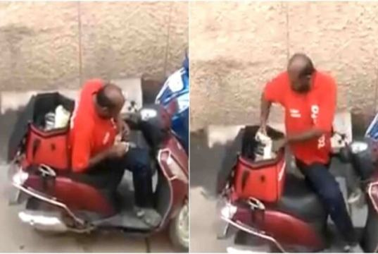 बीच रास्ते में खाना खाते हुए कैमरे में कैद हुआ फ़ूड डिलीवरी बॉय, वीडियो हुआ वायरल